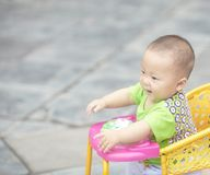 Baby  boy in stroller. Seven month old baby boy in stroller on street Royalty Free Stock Photos