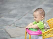 Baby  boy in stroller. Seven month old baby boy in stroller on street Royalty Free Stock Image