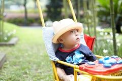 Baby boy in stroller Stock Photo