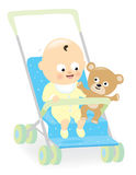 Baby boy in stroller with teddy bear Royalty Free Stock Image