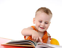 Baby boy studies to read Royalty Free Stock Photo