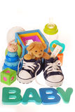 Baby boy stuffs. Baby boy`s shoes with pregnancy ,teddy bear ,toys ,stuffs and letters b,a,b,y isolated on white Royalty Free Stock Photography