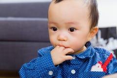 Baby boy sucking his finger Stock Photos