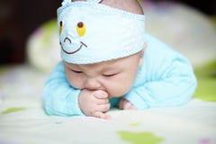 Baby boy sucking thumb Stock Photos