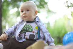 Baby boy in summer park Stock Photos
