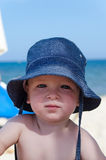 Baby boy with sun hut Royalty Free Stock Photo
