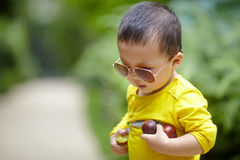 Baby boy with sunglasses Royalty Free Stock Photos