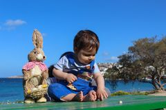 Baby boy surounded with flowers easter concept royalty free stock photography