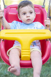 Baby boy in swing royalty free stock photo