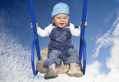 Baby boy on swing Royalty Free Stock Photo