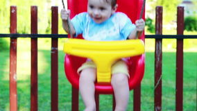 Baby boy in a swing Royalty Free Stock Photo