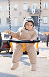 Baby boy on a swing stock photos