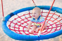 Baby boy on a swing Royalty Free Stock Image