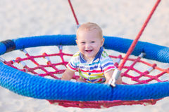 Baby boy on a swing Stock Image