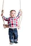 Baby boy on a swing Stock Images