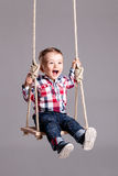 Baby boy on a swing Royalty Free Stock Photography
