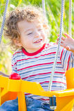 Baby boy in a swing Royalty Free Stock Photos