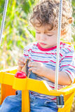 Baby boy in a swing Stock Photography