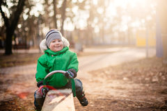 baby boy swinging in autumn park Royalty Free Stock Photography