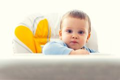 Baby boy at table Royalty Free Stock Image