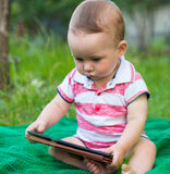Baby boy with tablet Royalty Free Stock Photography