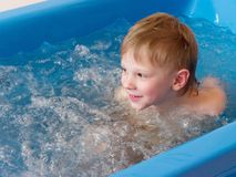 Baby boy is taking a bath with bubbles. Jacuzzi bubble bath procedure.  stock images