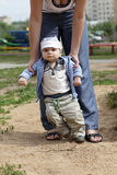 Baby boy taking first steps Royalty Free Stock Photo
