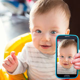 Baby boy taking selfie Stock Photo