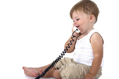 Baby boy talking on the phone Stock Image