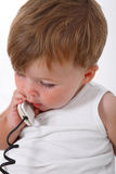 baby boy talking on the phone Stock Images