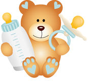 Baby boy teddy bear with baby pacifier and bottle milk Royalty Free Stock Photography