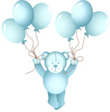 Baby boy teddy bear flying holding a balloons Royalty Free Stock Images