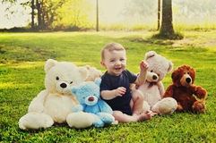 Baby boy with teddy bears Stock Images