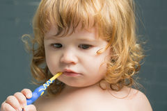 Baby boy with teeth brush Stock Photos
