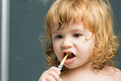 Baby boy with teeth brush stock images