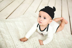 Baby boy in toddler and mouse hat on wooden floor Royalty Free Stock Photo