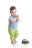 Baby boy toddler playing with toy car Stock Image