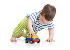 Baby boy toddler playing with toy car Royalty Free Stock Image