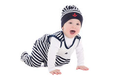 Baby boy toddler in sailor clothes crawling isolated on white Stock Image