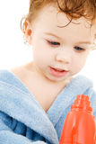 Baby boy with toy hair dryer Stock Photography