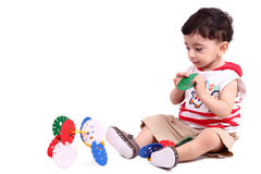 Baby boy with toy Stock Images