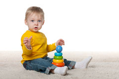 Baby boy with a toy Royalty Free Stock Photography