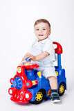 Baby boy with a toy truck Royalty Free Stock Photo