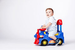 Baby boy with a toy truck Royalty Free Stock Image