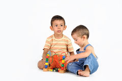 Baby and boy with a toy Stock Photo