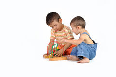 Baby and boy with a toy Royalty Free Stock Image