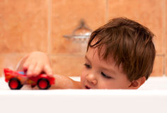 Baby boy toying in bathroom Royalty Free Stock Photo