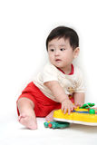 Baby boy with toys. On white background Royalty Free Stock Images