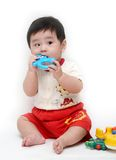 Baby boy with toys. On white background Royalty Free Stock Photos