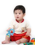 Baby boy with toys. On white background Stock Photo